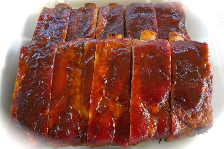 Coat ribs with barbecue sauce